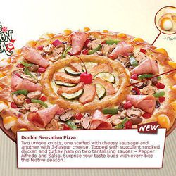 """<a href=""""http://eater.com/archives/2012/12/20/the-double-sensation-pizza-huts-pizza-inside-a-pizza.php"""">Behold Pizza Hut Singapore's Insane Pizza Within a Pizza</a>"""