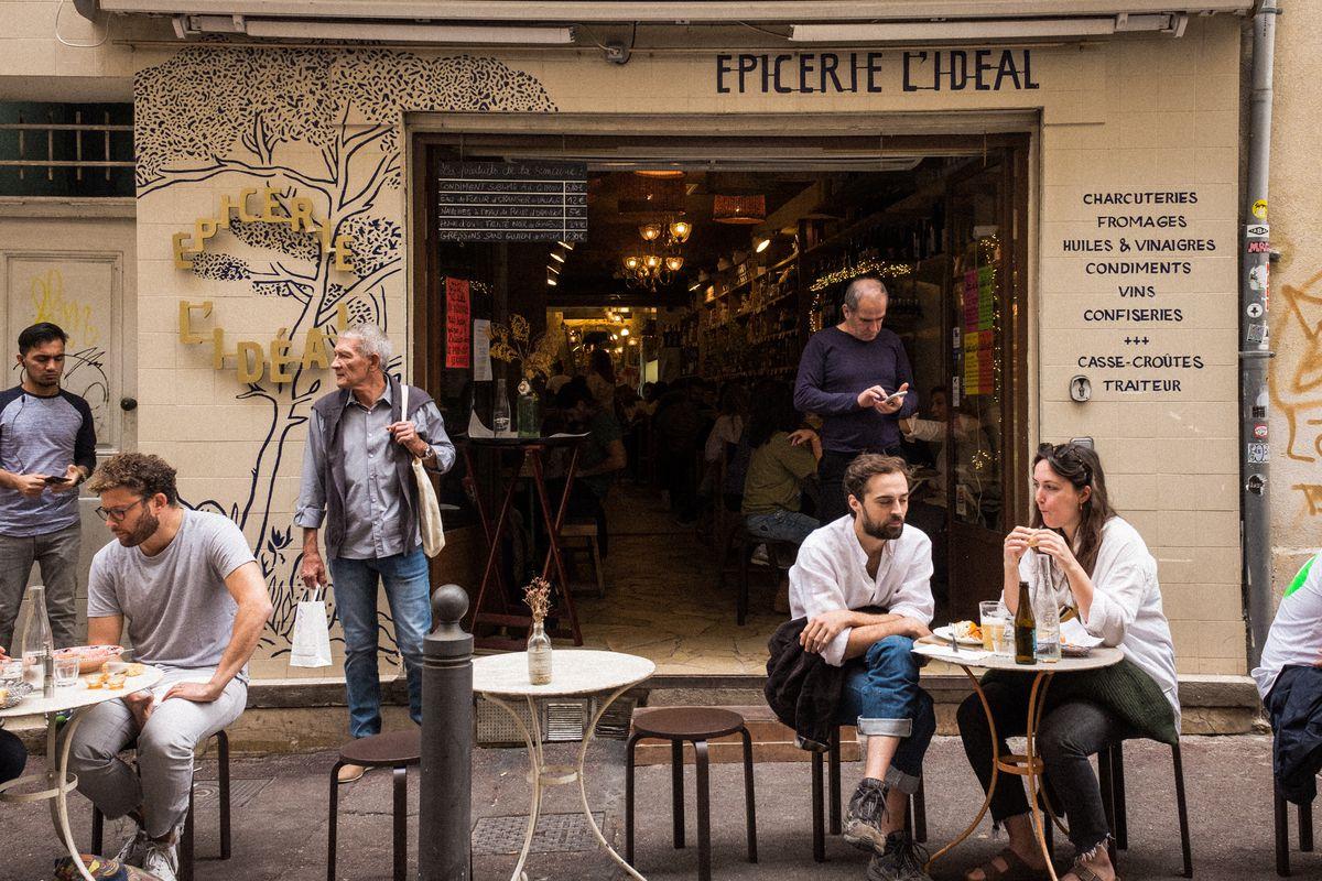 Sidewalk tables outside L'Epicerie Ideal
