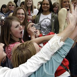 """David Archuleta fans wave and take pictures as the """"American Idol"""" finalist leaves The Gateway in Salt Lake City Friday."""