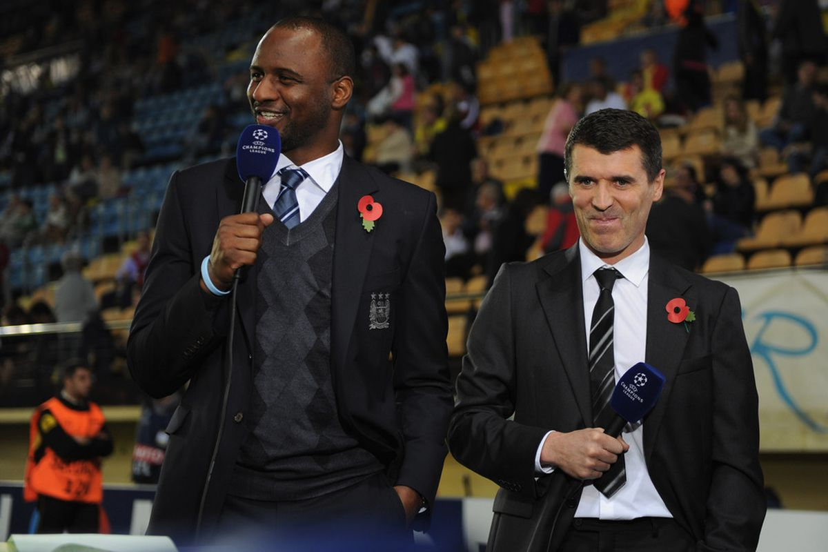Viera pictured with Roy Keane. No doubt, the Frenchman is speakin very wise words, while Roy Keane resists the urge of stuffing his microphone down his trap! (Photo by Michael Regan/Getty Images)