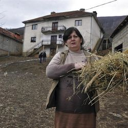 """Time Osmankaj, a relative of Sami Osmankac, carries feed to livestock in front of the house where naturalized American citizen Sami Osmakac, 25, was born, in the Osmankaj family compound in the village of Lubizde, Kosovo Tuesday, Jan 10, 2012. Kosovo-born man Sami Osmakac was charged with plotting to attack Tampa-area nightclubs and a sheriff's office with bombs and an assault rifle to avenge wrongs done to Muslims, according to federal authorities. According to a federal complaint, Osmakac recorded an eight-minute video shortly before his arrest explaining why he wanted to bring terror to his """"victims' hearts"""" in the Tampa Bay area. (AP Photo/Visar Kryeziu)"""