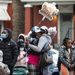 Dozens of family members and supporters of 7-year-old Jaslyn Adams gather for a vigil outside the girl's grandmother's West Side home, Wednesday evening, April 21, 2021. Jaslyn was fatally shot Sunday, April 18, while in line at a McDonald's drive-thru with her father, who suffered one gunshot wound to the back and survived.