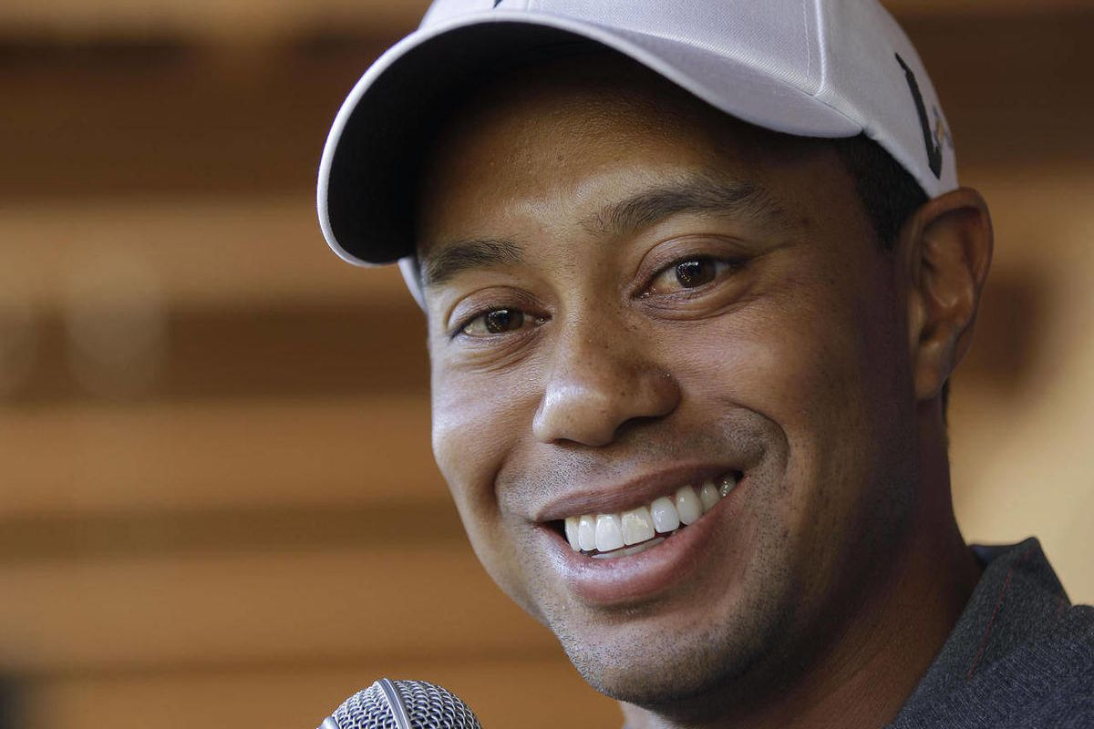 FILE - This Feb. 21, 2012 file photo shows Tiger Woods answering questions during a news conference before playing a practice round at the Match Play Championship golf tournament, in Marana, Ariz. Instead of a news conference before this week's Wells Farg