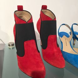 Suede and elastic poppy red boots, $50
