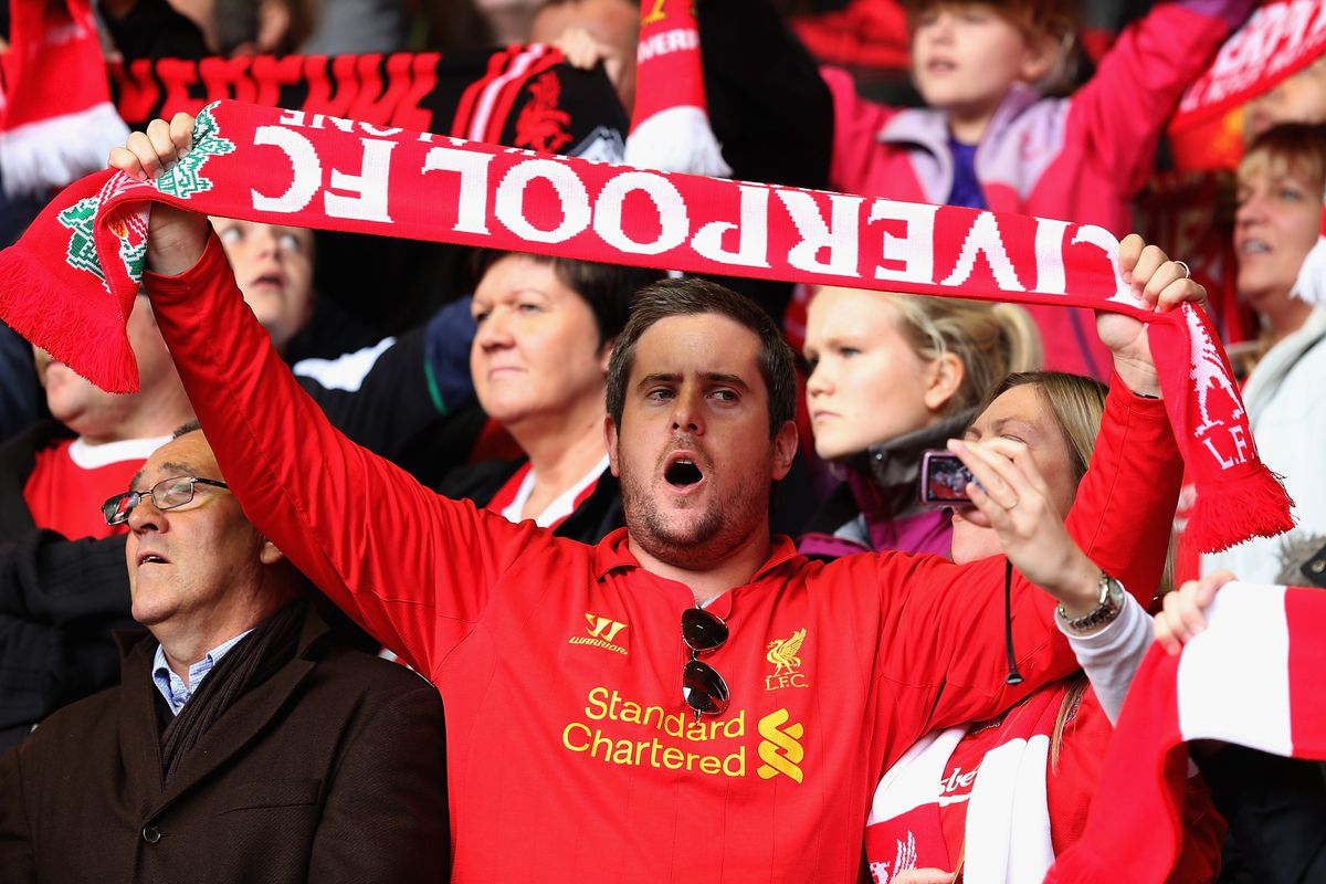 Don't be this guy. Don't go all the way to Anfield and then hold your scarf upside down during YNWA.