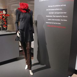 """In this Thursday, Sept. 13, 2012 photo, an ensemble created by fashion designer Maria Pinto is seen in the new exhibit """"Fashion and The Field Museum Collection: Maria Pinto"""" opening Friday, Sept. 14 at the museum in Chicago. This design was inspired by the Chinese theatrical headdress at left.  The exhibit features Pinto designs alongside antiquities from the museum."""