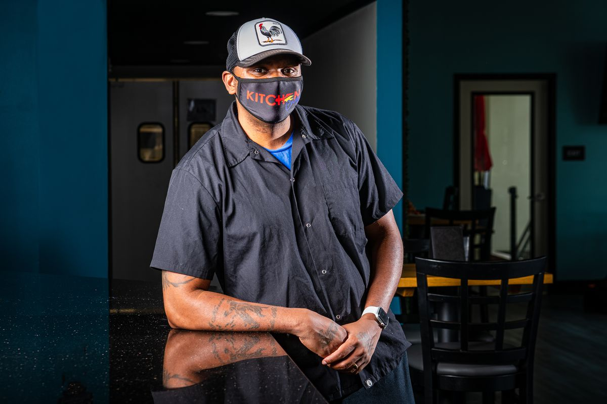 KitchenCray chef-owner J.R. Robinson poses for a portrait while wearing a protective face mask