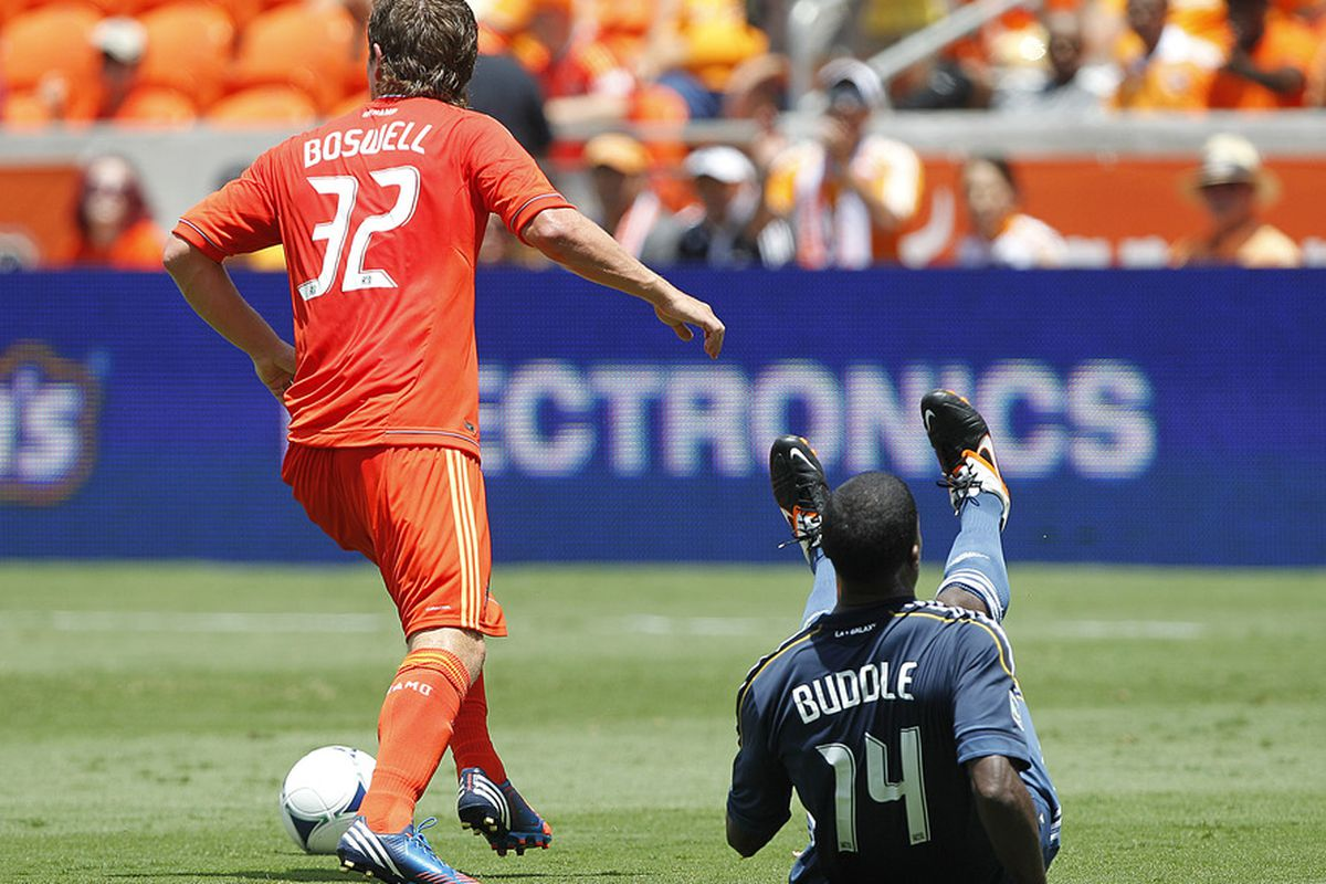 HOUSTON, TX - MAY 26:  Edson Buddle #14 of the Los Angeles Galaxy attempts to get around Bobby Boswell #32 of the Houston Dynamo at BBVA Compass Stadium on May 26, 2012 in Houston, Texas.  (Photo by Bob Levey/Getty Images)