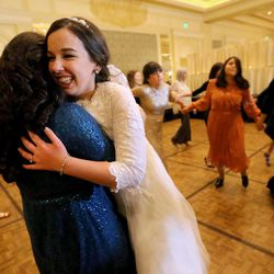 A guest hugs Chaya Zippel during her traditional Chabad Lubavitch Jewish wedding at the Grand America Hotel in Salt Lake City on Monday, Sept. 12, 2016. Zippel married Rabbi Mendy Cohen of Montreal.