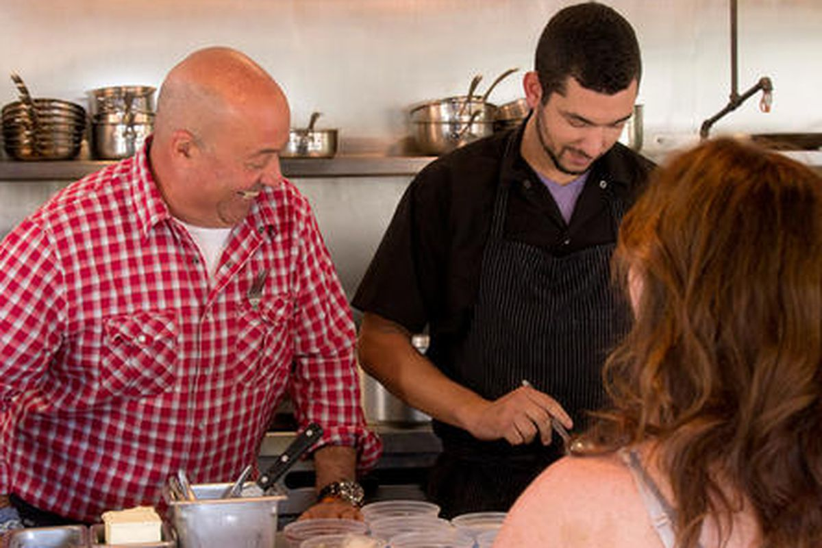 Andrew Zimmern stops by Ned Elliott's Foreign & Domestic on North Loop with Rainey Street nightclub empire owner Bridget Dunlap.