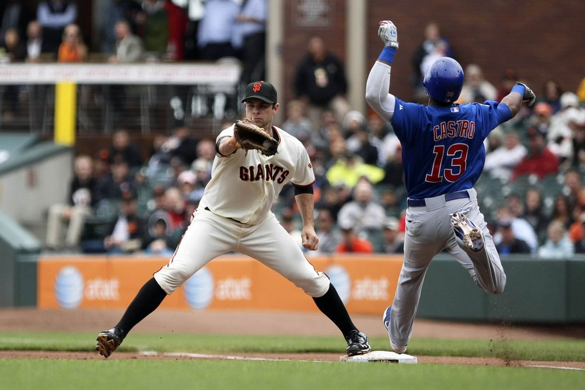 June 4, 2012; San Francisco, CA, USA;San Francisco Giants first baseman Brandon Belt (9) forces out Chicago Cubs shortstop Starlin Castro (13) during the second inning at AT&T Park. Mandatory Credit: Kelley L Cox-US PRESSWIRE