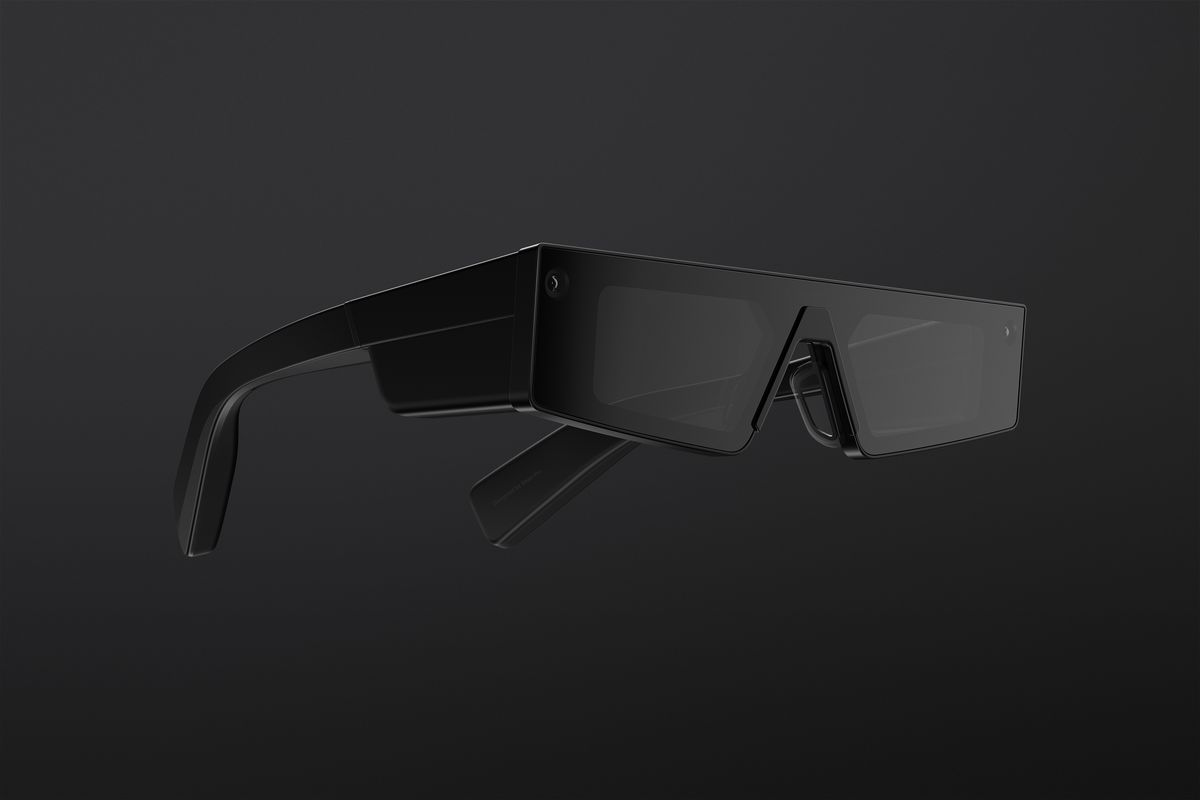 Snap's fourth generation Spectacles are black, with thick areas at the hinges to house components. They feature angular lenses and cameras beside each hinge.