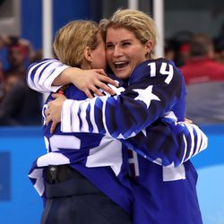 Kendall Coyne #26 and Brianna Decker #14 of the United States celebrate after winning gold.