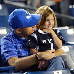 Channen Day and his daughter Wren of central Arizona talk as they watch the players warm up as BYU and Mississippi State prepare to play in Provo at LaVell Edwards Stadium on Friday, Oct. 14, 2016.