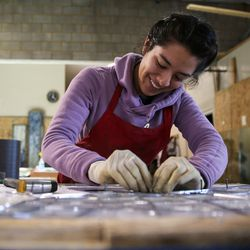 """Zabdi Zetina works on """"The Roots of Knowledge,"""" a 200-foot-long stained glass installation for Utah Valley University, at Holdman Studios in Lehi on Friday, Nov. 4, 2016. The university announced a $1.5 million donation from philanthropists Marc and Deborah Bingham that will enable the completion of the massive stained glass installation."""