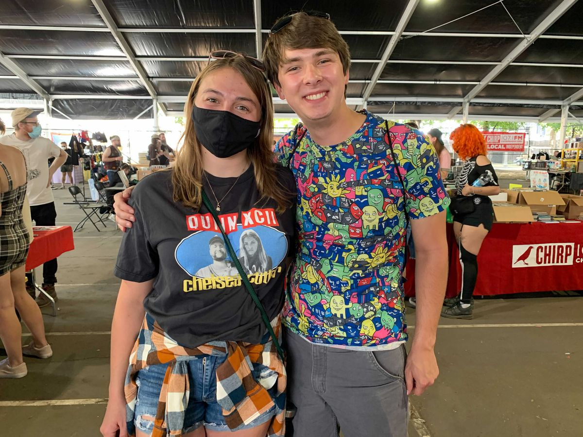 Haley Leonhard (left) of Manitowoc, Wisconsin, and Andrew Lindaas, of Madison, Wisconsin, pose for a photo at the Renegade Craft Show popup at Pitchfork Music Festival.