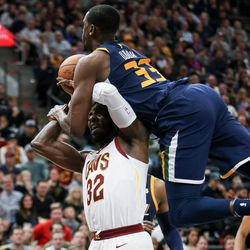 Utah Jazz center Ekpe Udoh (33) is charged with a foul as he comes down on Cleveland Cavaliers forward Jeff Green (32) at Vivint Arena in Salt Lake City on Saturday, Dec. 30, 2017.
