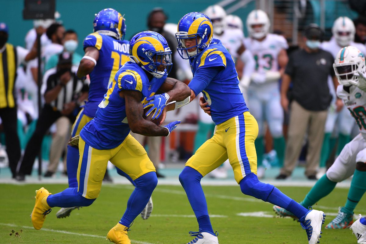 Jared Goff #16 of the Los Angeles Rams hands the ball to Cam Akers #23 against the Miami Dolphins at Hard Rock Stadium on November 01, 2020 in Miami Gardens, Florida.