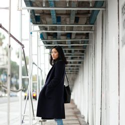 """Ann of <a href=""""http://www.andyheart.com""""target=""""_blank"""">Andy Heart</a> is wearing a Whistles coat, Frame Denim jeans, <a href=""""http://www.adidas.com/us/gazelle-shoes/032622_530.html?SSAID=687298""""target=""""_blank"""">Adidas</a> sneakers, a <a href=""""http://www."""