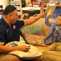 Kalani Sitake high fives his son KK, 5, at home in Provo on Friday, March 11, 2016.