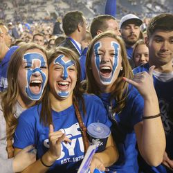 BYU fans celebrate as they leave the stadium after BYU defeated Mississippi State 28-21 in overtime in Provo at LaVell Edwards Stadium on Friday, Oct. 14, 2016.
