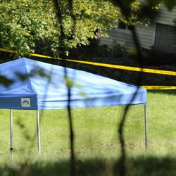 A blue tent protects the scene of a fatal shooting in New Fairfield, Conn., Thursday, Sept, 27, 2012. Police say Jeffrey Giuliano shot a masked teenager in self-defense during what appeared to be an attempted burglary early Thursday morning, then discovered that he had killed his son, Tyler.