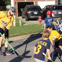 Nick Bonino waits for his winger to feed him the ball in front of the goal during an intense street hockey game in Nolensville.