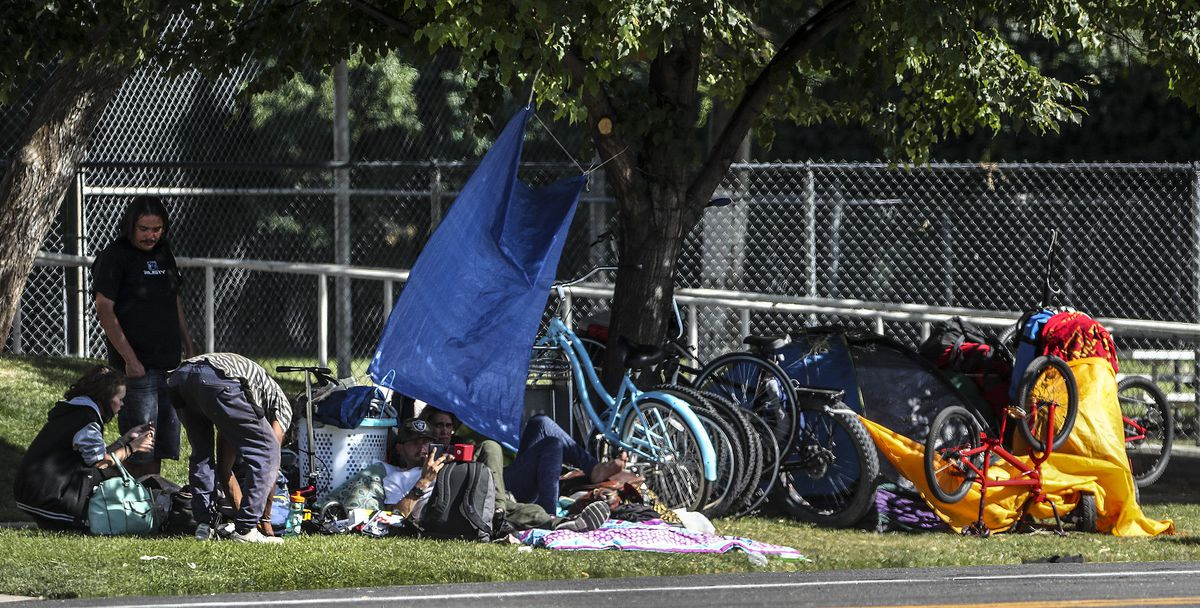 People camp in the park strip on 300 South near 700 East in Salt Lake City on Tuesday, Aug. 11, 2020.