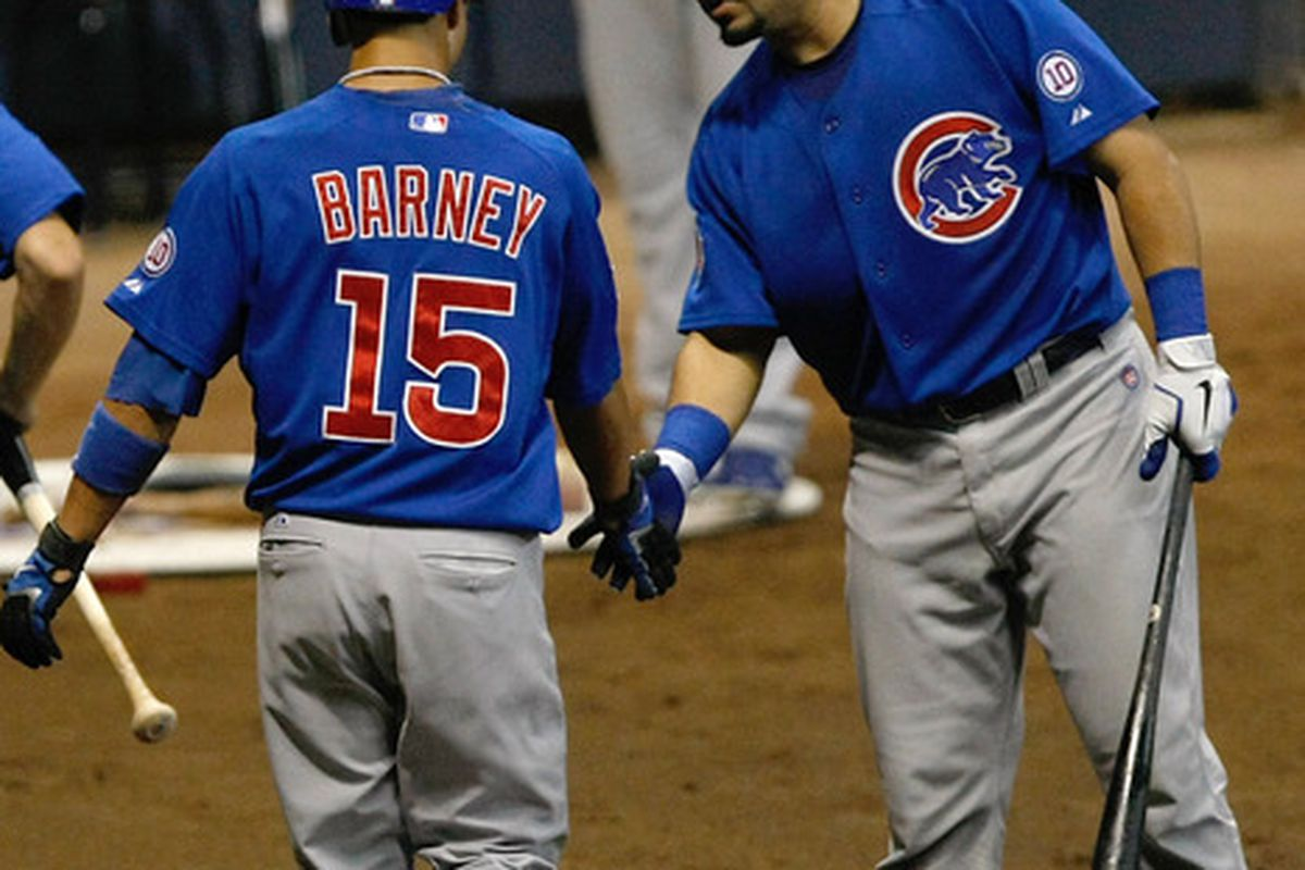 What is Geo saying to Darwin? Darwin Barney of the Chicago Cubs is congratulated by Geovany Soto after scoring a run during a game against the Milwaukee Brewers at Miller Park in Milwaukee, Wisconsin. (Photo by Scott Boehm/Getty Images)