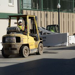 11:01 a.m. Concrete barricade being delivered -