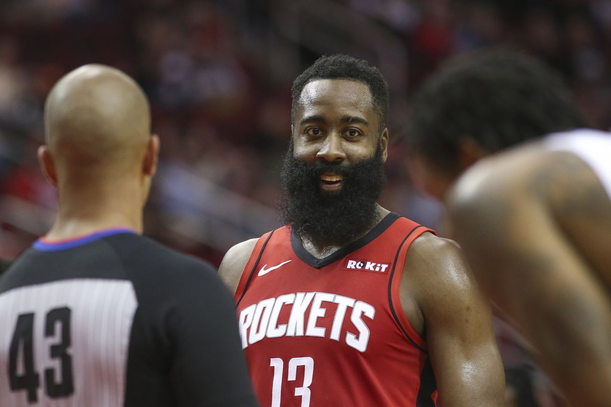 Houston Rockets guard James Harden laughs after he made a basket while being fouled by the Sacramento Kings in the first quarter at Toyota Center.