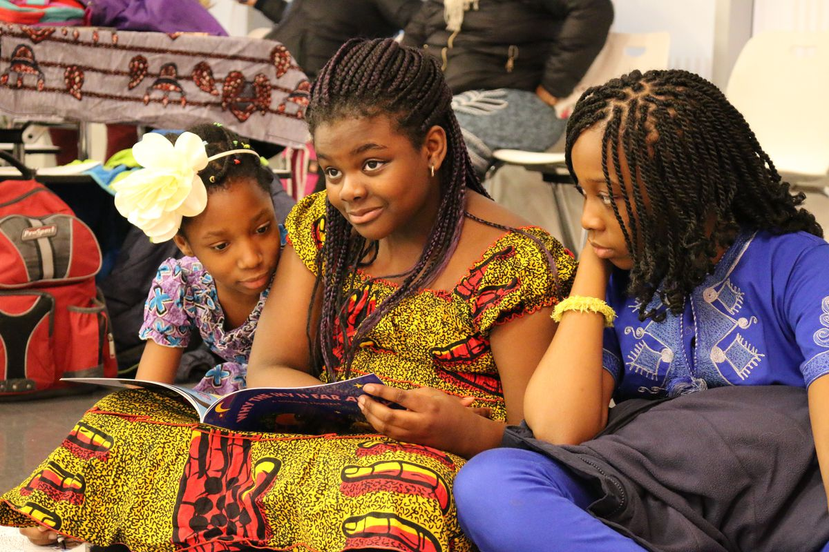 """At a recent Celebrate Africa event, students listened to a teacher read the Nigerian folktale """"Why the Sky is Far Away."""""""