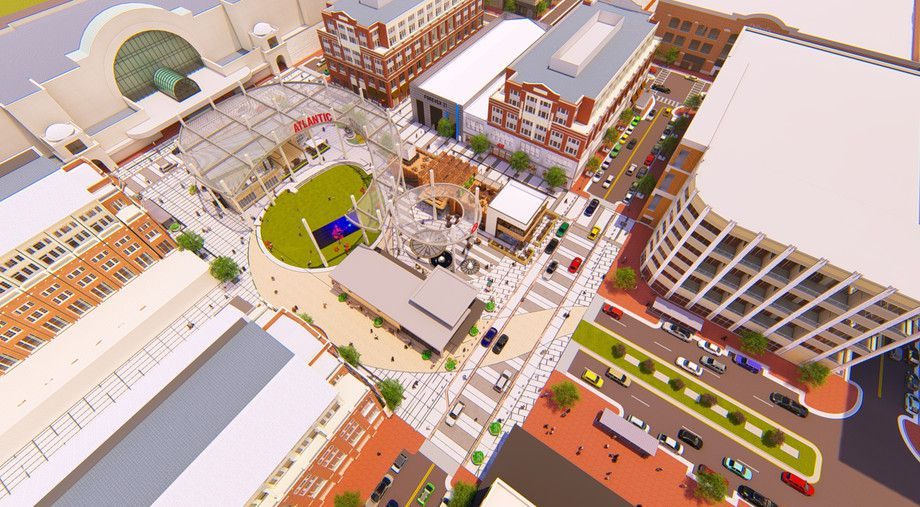 A rendering that show a central green space with buildings and a theater around it.
