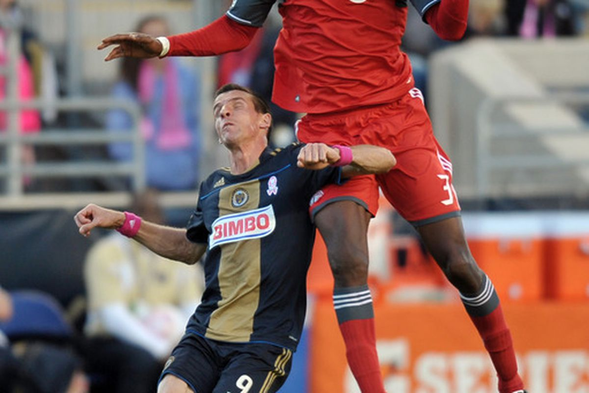 So many things in this picture.  The ridiculously dominant jump, the amusing facial expression, the sneaky elbow to the nads, but mainly...what the hell is up with Le Toux's boots?  Seriously.