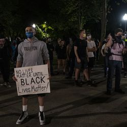 Protesters organize around the Kenosha County Courthouse minutes after Kenosha's curfew went into effect during a protest over the shooting of Jacob Blake, Tuesday, Aug. 25, 2020, in Kenosha, Wis.