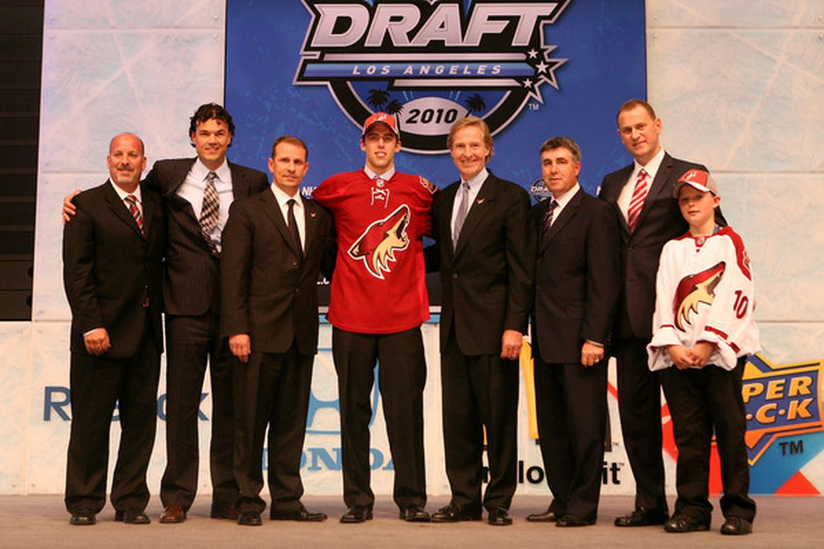 LOS ANGELES, CA - JUNE 25:  Brandon Gormley, drafted 13th overall by the Phoenix Coyotes, poses on stage with team personnel. (Photo by Bruce Bennett/Getty Images)