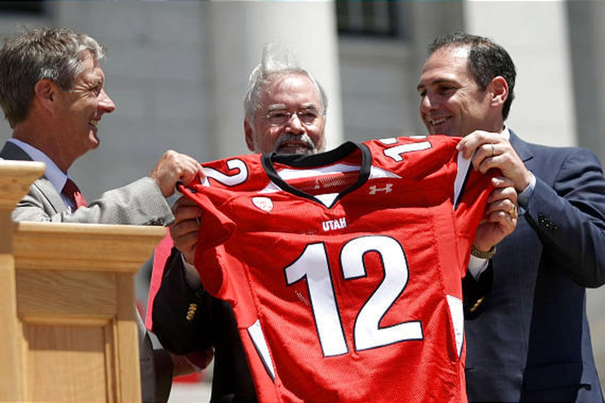 Athletics Director Chris Hill, University of Utah Interim President Lorris Betz and Pac-12 Commissioner Larry Scott hold up a Pac-12 Day jersey during Pac-12 Celebration Day at the State Capitol in Salt Lake City on Friday, July 1, 2011.