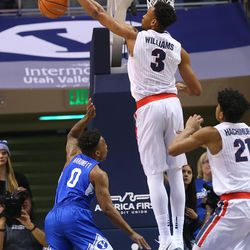 Brigham Young Cougars guard Jahshire Hardnett (0) has his shot blocked by Gonzaga Bulldogs forward Johnathan Williams (3) as BYU and Gonzaga play in an NCAA basketball game in the Marriott Center in Provo on Saturday, Feb. 24, 2018. Gonzaga won 79-65.