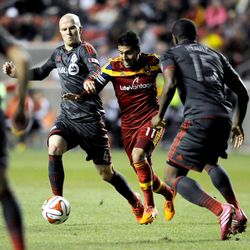 Real Salt Lake midfielder Javier Morales (11) fights for control of the ball with Toronto FC midfielder Michael Bradley (4) and Toronto FC defender Doneil Henry (15) during a game at Rio Tinto Stadium in Sandy on Saturday, March 29, 2014.