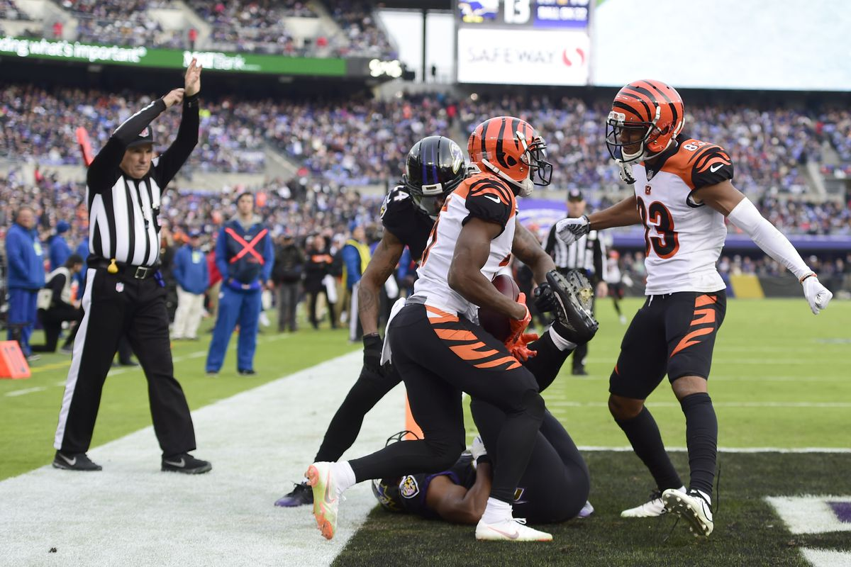 Cincinnati Bengals wide receiver John Ross (15) celebrates with wide receiver Tyler Boyd (83) after catching aa touchdown in the third quarter against the Baltimore Ravensn at M&T Bank Stadium.