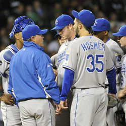 Manager Ned Yost #3 of the Kansas City Royals (C) talks to relief pitcher Blake Wood #38 as the rest of the team gather on the mound during the eighth inning against the Chicago White Sox at U. S. Cellular Field on September 24, 2011 in Chicago, Illinois.
