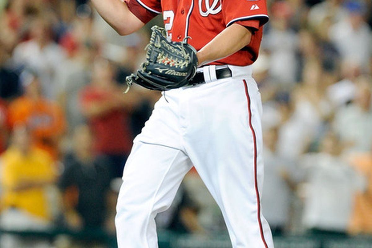 WASHINGTON, DC - JULY 30:  Drew Storen #22 of the Washington Nationals celebrates after the final out in a 3-0 victory against the New York Mets at Nationals Park on July 30, 2011 in Washington, DC.  (Photo by Greg Fiume/Getty Images)