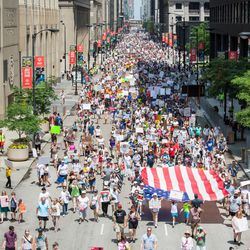The Families Belong Together march makes its way south on Clark St.   James Foster/For the Sun-Times