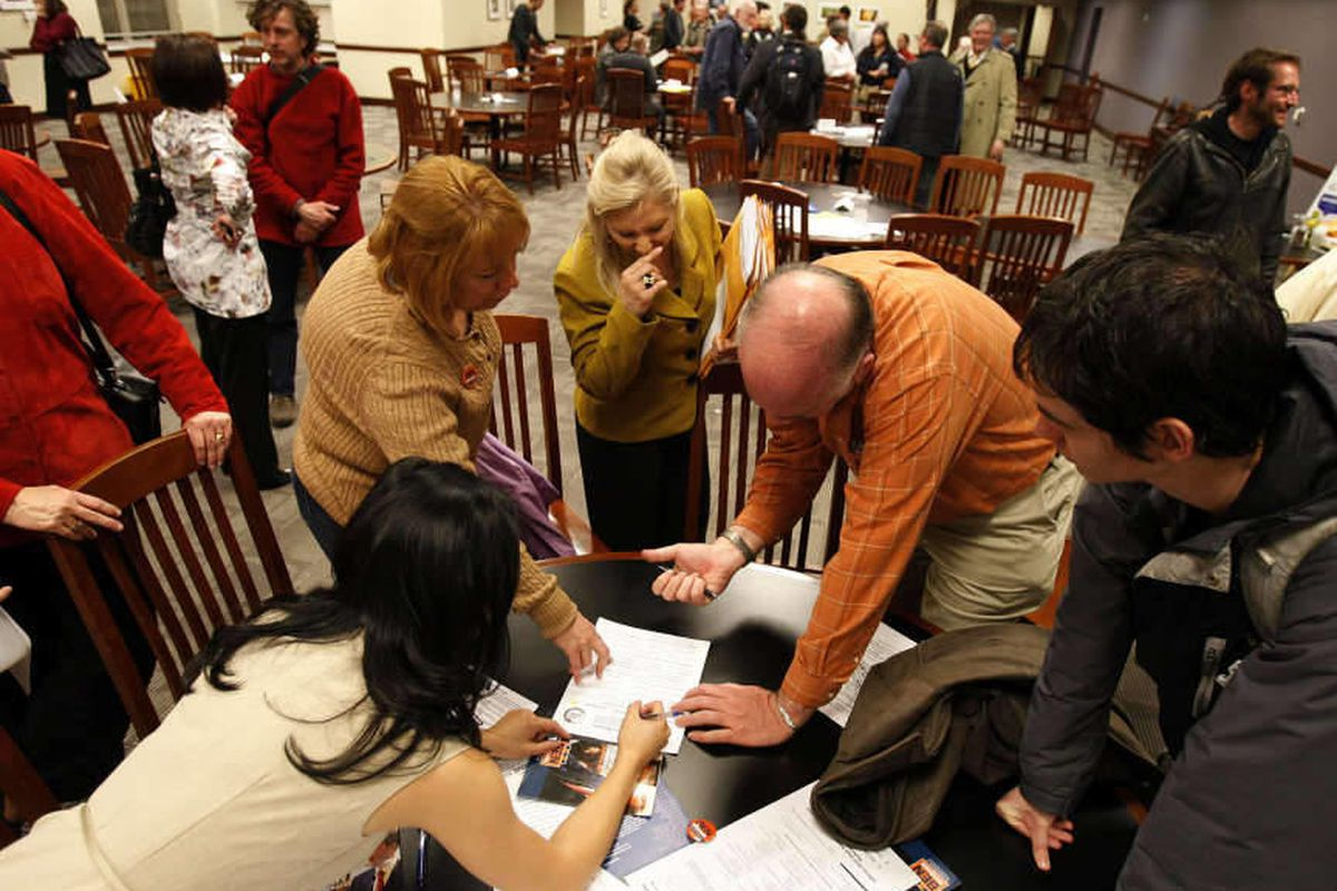 Members of precinct 41 record election results as a Democratic caucus is held at the Utah Capitol in Salt Lake City, Tuesday, March 13, 2012. At front left is Angelina Tsu, the new chair of the precinct.
