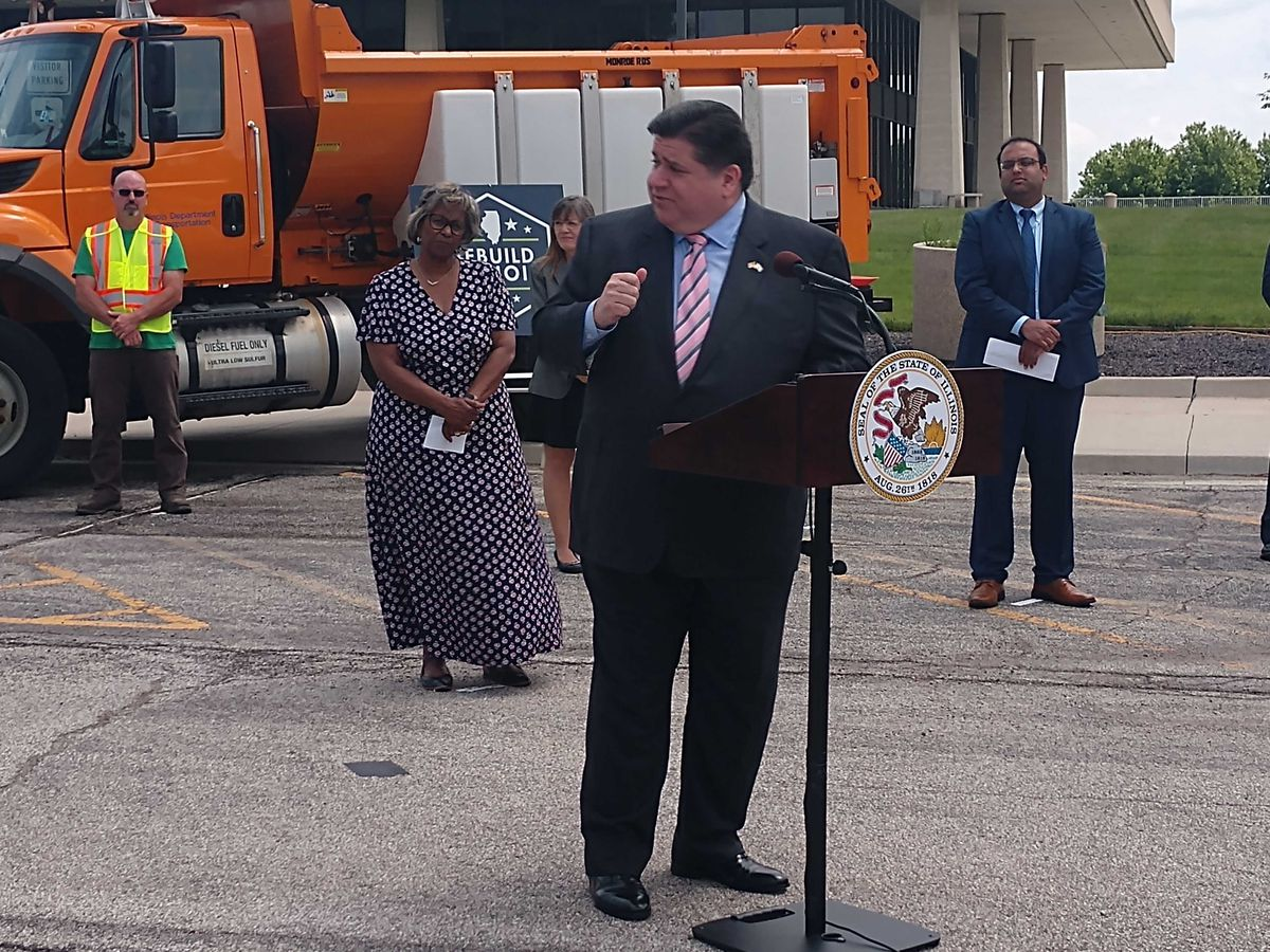 Gov. J.B. Pritzker speaks at a news conference outside the Illinois Department of Transportation offices in Springfield on Wednesday.