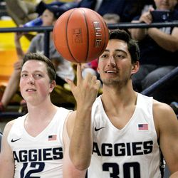 Utah State's Abel Porter, right, and Justin Bean enjoy some time on the bench during the Aggies' Primetime Madness event on Oct. 12, 2017 at the Spectrum.