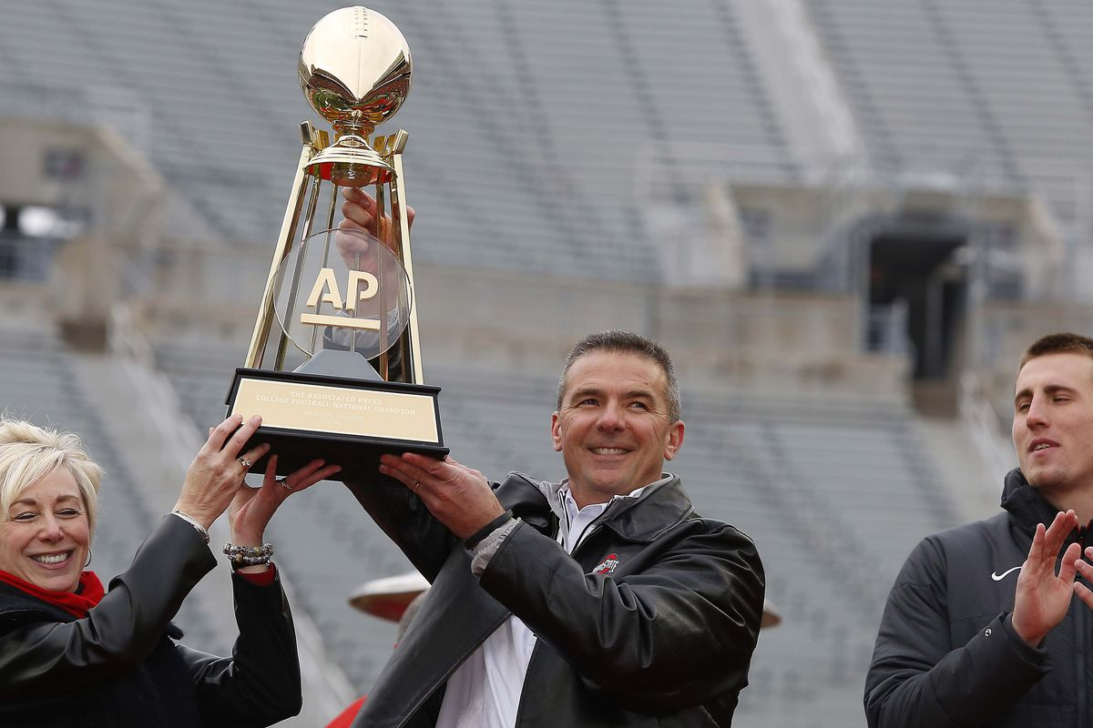 No College Football Playoff means no College Football Playoff trophy. Urban Meyer would make do with the previous gold standard.