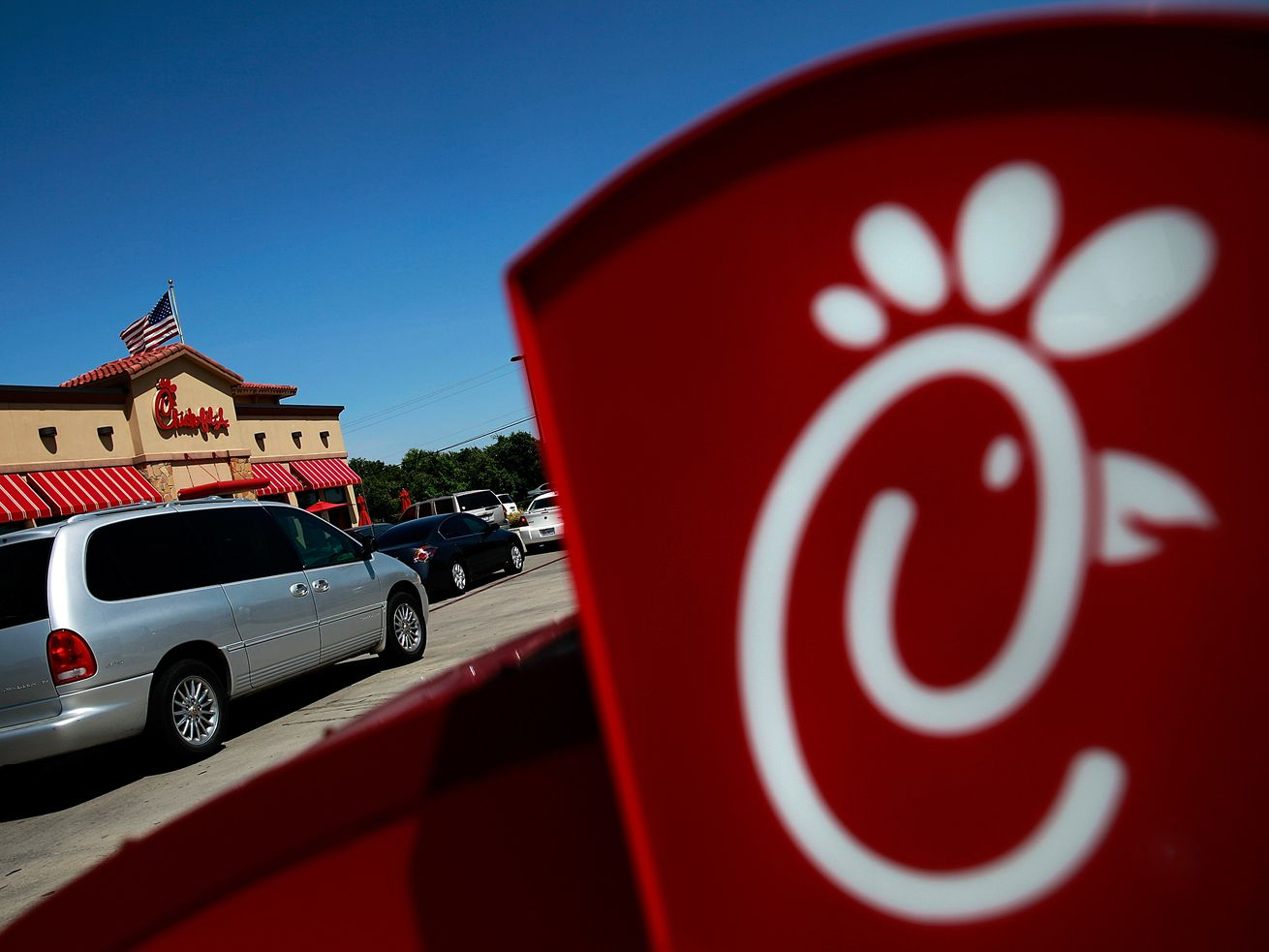 Drive-through customers wait in line at a Chick-fil-A restaurant on August 1, 2012, in Fort Worth, Texas.