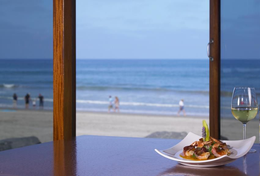 Dinner with ocean view backdrop