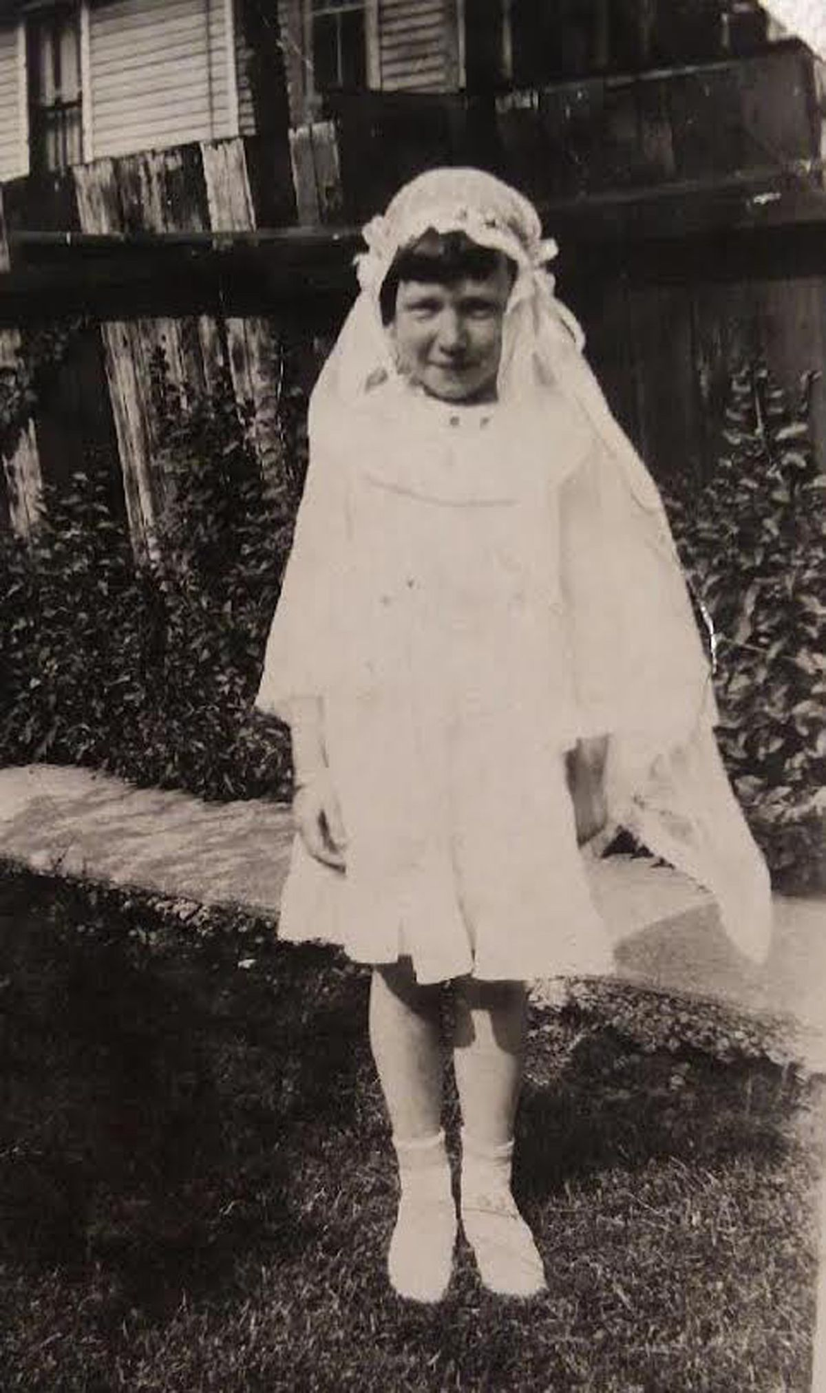 Georgia Sheehan at her first Communion at the church where she was baptized and buried, St. Gabe's in Canaryville.